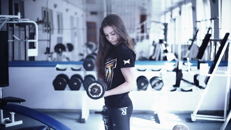 Woman Lifting Weights Gym