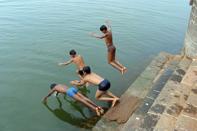 Boys Diving into Water