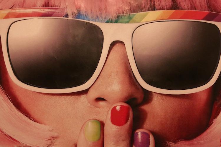 Girl in Sunglasses with Fingertips