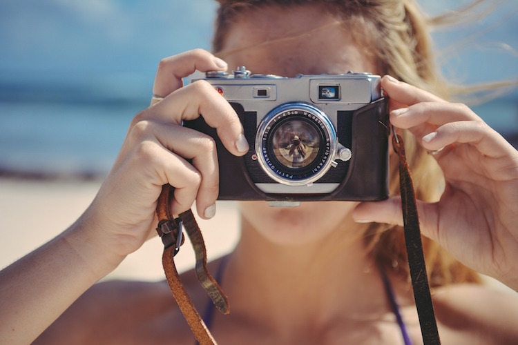Blonde woman with camera