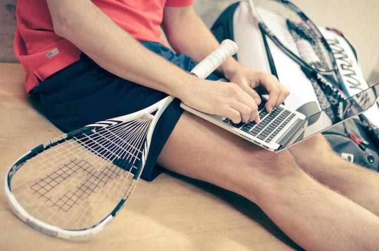 Tennis Player on Laptop